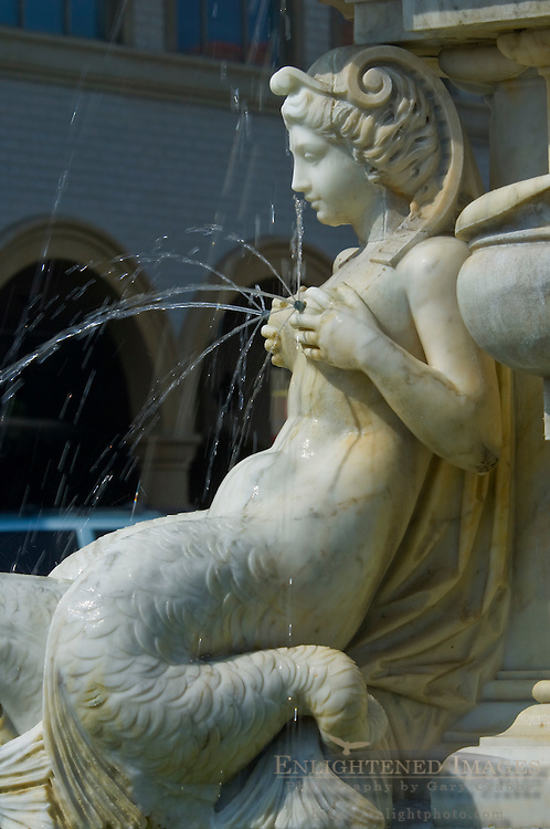 Water from breasts of classical style fountain statues at Malaga Cove Plaza, Palos Verdes Peninsula, California