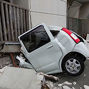 KUMAMOTO, JAPAN - APRIL 18: A car was collapsed by fallen apartment is seen after an earthquake on April 18, 2016 in Mashiki, Kumamoto, Japan. At least nine people have died in a powerful earthquake, with a preliminary magnitude of 6.4, and followed by magnitude 7.3 quake that struck Kumamoto Prefecture yesterday.<br /> <br /> Photo: Richard Atrero de Guzman