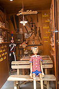 Italy, Rome, An Italian carpenter toy maker carving wooden dolls