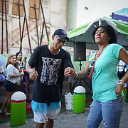SAN JUAN, PUERTO RICO -- FEBRUARY 3, 2019: <br /> Dancing to salsa music blaring from speakers in the Callejon de la Calle Tanca (Tanca Street alley) in Old San Juan on a Sunday afternoon. The spot is a popular destination to enjoy live traditional Puerto Rican Bomba and Plena music.  <br /> (Photo by Angel Valentin)