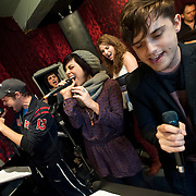 """December 5, 2013 - New York, NY: The cast of the NBC musical drama television series """"Smash"""" including, at microphones in foreground from left, Jeremy Jordan, Krysta Rodriguez, and Andy Mientus, rehearse at Smash Studios at 36th Street in Manhattan on Thursday afternoon in preparation for their cabaret performance of """"HIT LIST,"""" which will premiere Sun, Dec 8 at 54 Below.  Also pictured, in background from left, are Benjamin Rauhala (piano), Molly Hager (vocals), Monet Julia Sabel (vocals), and Shannon Ford (drums). CREDIT: Karsten Moran for The New York Times"""