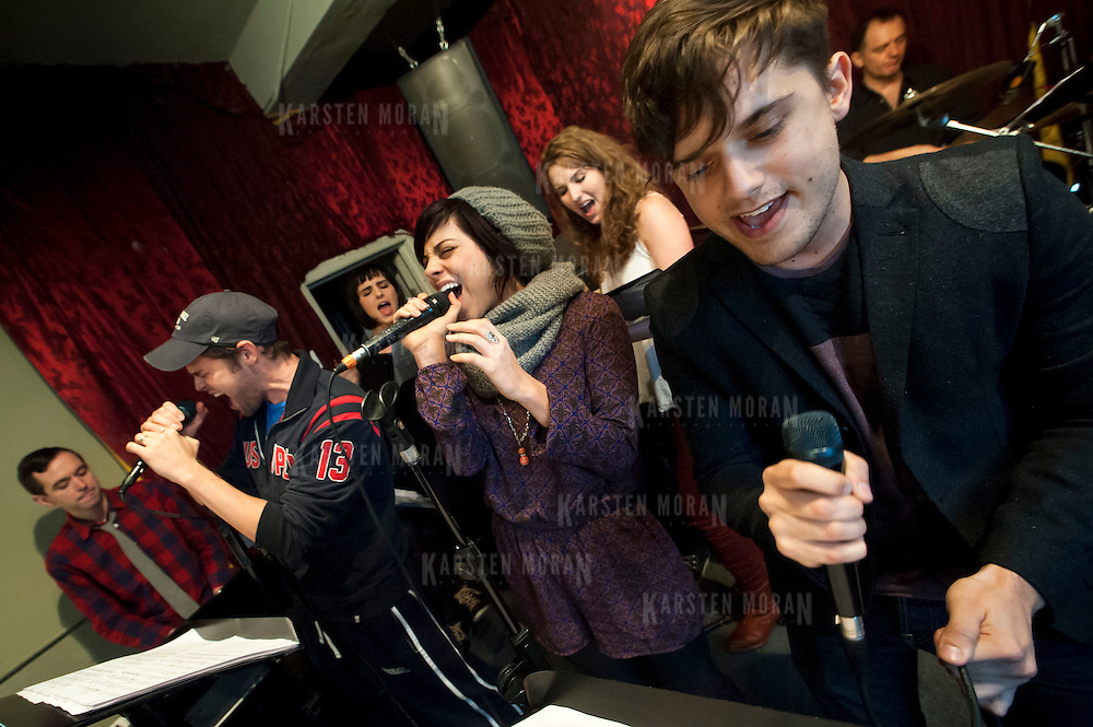 "December 5, 2013 - New York, NY: The cast of the NBC musical drama television series ""Smash"" including, at microphones in foreground from left, Jeremy Jordan, Krysta Rodriguez, and Andy Mientus, rehearse at Smash Studios at 36th Street in Manhattan on Thursday afternoon in preparation for their cabaret performance of ""HIT LIST,"" which will premiere Sun, Dec 8 at 54 Below.  Also pictured, in background from left, are Benjamin Rauhala (piano), Molly Hager (vocals), Monet Julia Sabel (vocals), and Shannon Ford (drums). CREDIT: Karsten Moran for The New York Times"