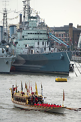 © Licensed to London News Pictures. 09/09/2015. London, UK. British royal rowbarge Gloriana leading the flotilla as it passes in front of HMS Belfast . A Royal River Salute takes place at Tower Bridge in London to mark the Queen becoming the longest reigning monarch in British history. The Queen will have reigned for 63 years and seven months , passing the record set by her great-great-grandmother Queen Victoria. Photo credit: Ben Cawthra/LNP