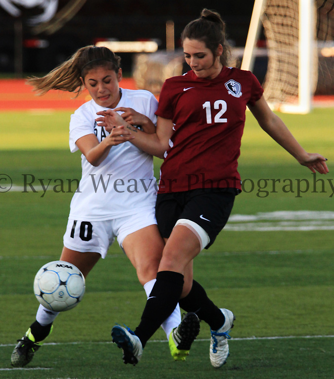 Ray-Pec's Taylor Rayos, left, collides with Gianna Palmentere of Lee's Summit North on Monday. After holding the Broncos at bay for 50 minutes, Palmentere broke through for two goals in a 4-0 win at Panthers Stadium.