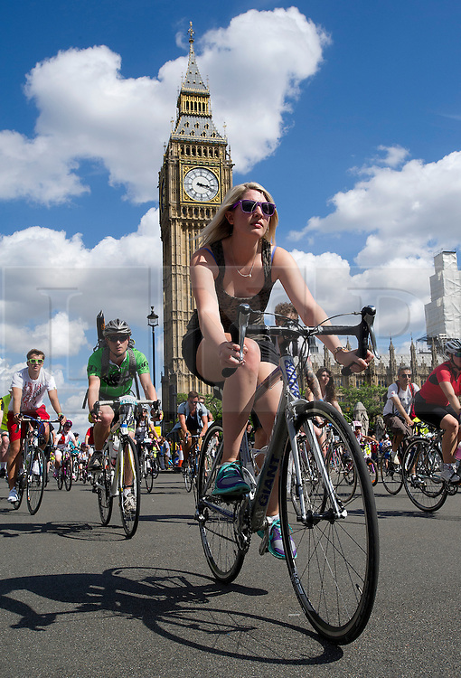 © London News Pictures. 03/08/2013. London, UK. Cyclists pass in front of Big Ben, Elizabeth Tower in Westminster as Cycling enthusiasts of all ages take part in the Prudential RideLondon cycling event through central London. RideLondon is an annual two-day festival of cycling, part of the legacy of the 2012 Games. Photo credit: Ben Cawthra/LNP