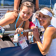 August 22, 2016, New Haven, Connecticut: <br /> Elena Vesnina of Russia poses for a selfie photograph with a fan after winning a match on Day 4 of the 2016 Connecticut Open at the Yale University Tennis Center on Monday August  22, 2016 in New Haven, Connecticut. <br /> (Photo by Billie Weiss/Connecticut Open)