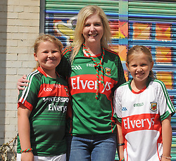 From Ballaghadeereen Gabrielle and Anastisia Skinner with Elaine McGovern <br /> on their way to the Croke park for the All Ireland quarter final replay<br /> Pic Conor McKeown