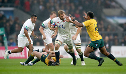 England's Chris Robshaw (centre) is tackled by Australia's Bernard Foley (second left) and Samu Kerevi (right) during the Autumn International at Twickenham Stadium, London.