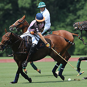 Kris Kampsen, K.I.G. in action during the White Birch Vs K.I.G Polo match in the Butler Handicap Tournament match at the Greenwich Polo Club. White Birch won the game 11-8. Greenwich Polo Club,  Greenwich, Connecticut, USA. 12th July 2015. Photo Tim Clayton