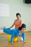 Personal Trainer Working with Senior Woman
