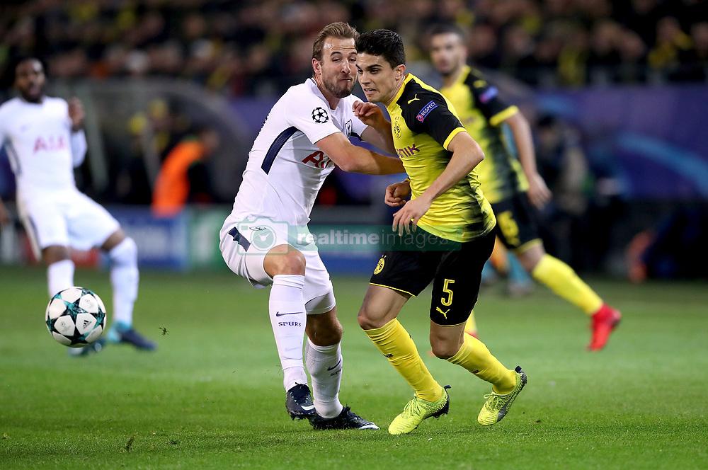 Borussia Dortmund's Marc Bartra (right) and Tottenham Hotspur's Harry Kane (left) battle for the ball