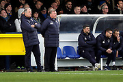 AFC Wimbledon manager Wally Downes, AFC Wimbledon first team coach Glyn Hodges and AFC Wimbledon coach Simon Bassey watching the game during the EFL Sky Bet League 1 match between AFC Wimbledon and Rochdale at the Cherry Red Records Stadium, Kingston, England on 8 December 2018.