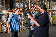 01/14/2016 132820 -- Garland, TX -- © Copyright 2016 Mark C. Greenberg<br /> <br /> From left: President and COO Rick Sukkar and CEO Alex Keechleof talk with warehouse manager Kevin Sadler in the warehouse of Garland, Texas based Monster Moto