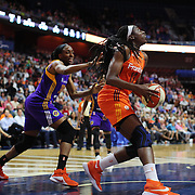 UNCASVILLE, CONNECTICUT- JULY 15:   Chiney Ogwumike #13 of the Connecticut Sun drives past her sister Nneka Ogwumike #30 of the Los Angeles Sparks  during the Los Angeles Sparks Vs Connecticut Sun, WNBA regular season game at Mohegan Sun Arena on July 15, 2016 in Uncasville, Connecticut. (Photo by Tim Clayton/Corbis via Getty Images)