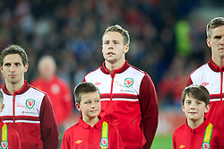 CARDIFF, WALES - Friday, October 12, 2012: Wales' Chris Gunter wearing a pink ribbon for missing five-year girl from Machynlleth April Jones before the Brazil 2014 FIFA World Cup Qualifying Group A match against Scotland at the Cardiff City Stadium. (Pic by David Rawcliffe/Propaganda)
