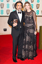© Licensed to London News Pictures. 14/02/2016. London, UK. ALEJANDRO GONZALEZ INARRITU and wife MARIA ELANDIA HAGERMANN arrive carpet for the EE British Academy Film Awards 2016 after party held at Grosvenor House . London, UK. Photo credit: Ray Tang/LNPPhoto credit: Ray Tang/LNP