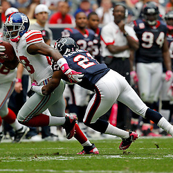 October 10, 2010; Houston, TX USA;New York Giants wide receiver Hakeem Nicks (88) is tackled by Houston Texans cornerback Brice McCain (21) during the first half at Reliant Stadium. Mandatory Credit: Derick E. Hingle