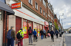 © Licensed to London News Pictures. 02/04/2020. London, UK. Over twenty shoppers socially distanced while they queue outside a branch of Iceland in Haringey, north London for over 45 minutes, with only three shoppers inside the store as coronavirus lockdown continues. Photo credit: Dinendra Haria/LNP