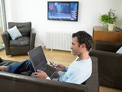 Dec. 14, 2012 - Man working at home (Credit Image: © Image Source/ZUMAPRESS.com)