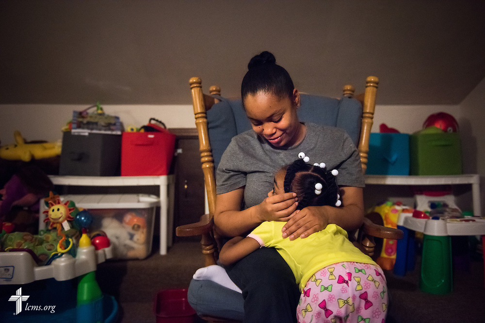 Nyia Harrell hugs her daughter Jada Harrell during evening playtime at A Place of Refuge on Tuesday, Sept. 1, 2015, in Milwaukee, Wis. LCMS Communications/Erik M. Lunsford