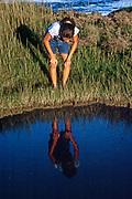 Girl searching a tidal pool, Cape Cod, MA