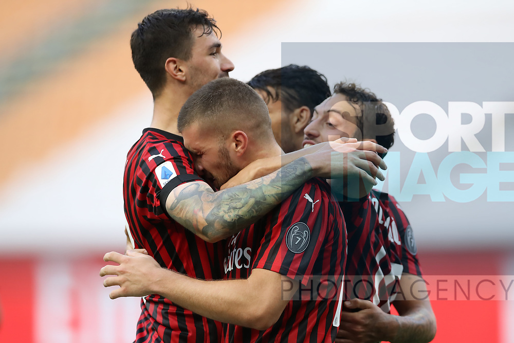AC Milan's Croatian striker Ante Rebic celebrates with team mates, Italian defender Alessio Romagnoli, Turkish midfielder Hakan Calhanoglu and Brazilian midfielder Lucas Paqueta during the Serie A match at Giuseppe Meazza, Milan. Picture date: 28th June 2020. Picture credit should read: Jonathan Moscrop/Sportimage