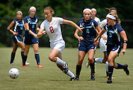 26 MAY 2012 -- TOWN & COUNTRY, Mo. -- Visitation Academy soccer player Liz Hopkins (8) pushes the ball past St. Dominic High School players Bri Ebenroth (4) and Katy Rood (3) during the MSHSAA Class 2 girls' soccer quarterfinals at Visitation Saturday, May 26, 2012. St. Dominic topped the Vivettes 8-1 to advance to Friday's semifinals against Helias Catholic High School at Blue Springs South High School. Photo © copyright 2012 Sid Hastings.