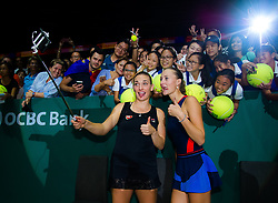 October 26, 2018 - Kallang, SINGAPORE - Timea Babos of Hungary & Kristina Mladenovic of France celebrate winning their doubles quarterfinal match at the 2018 WTA Finals tennis tournament (Credit Image: © AFP7 via ZUMA Wire)