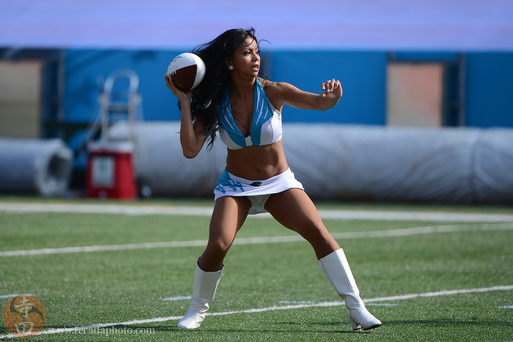 January 26, 2013; Honolulu, HI, USA; Carolina Panthers cheerleader Myra Aznar passes the football during a game between the NFL cheerleaders and the NFL mascots on Ohana Day at the 2013 Pro Bowl.