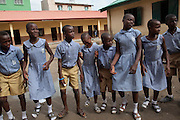 LAGOS, NIGERIA - JUNE 4, 2013. Youth Empowerment and Development Initiative (YEDI) promotes HIV awareness and life skills among youth in Lagos state through a soccer-based in-school curriculum. With the M∙A∙C grant, YEDI aims to reach 12,000 youth this year with its HIV/AIDS prevention programs. Here Grazrutsoka coaches work with Primary School children from Fazil Omar Primary School in Yaba. (Photo by Leonie Marinovich/Getty Images for MAC Cosmetics)