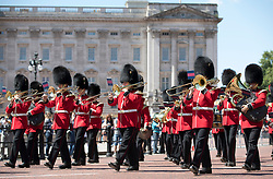 © Licensed to London News Pictures. 22/06/2018.  The Band of the Welsh Guards march from Buckingham Palace in warm morning sunshine. Most of the UK is expected to be enjoying high temperatures over the next 7-10 days.  London, UK. Photo credit: Peter Macdiarmid/LNP