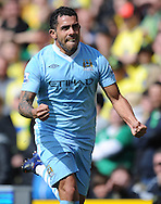 Picture by Andrew Timms/Focus Images Ltd. 07917 236526.14/04/12.Carlos Tevez of Manchester City celebrates scoring his second goal during the Barclays Premier League match against Norwich City at Carrow Road stadium, Norwich.