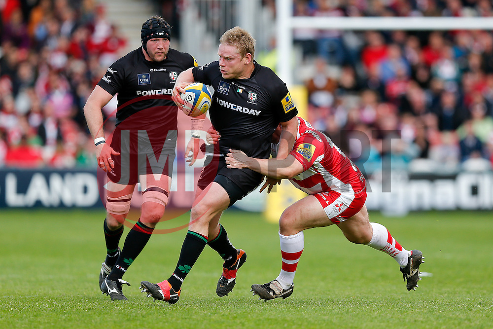 London Irish Prop Tom Court is tackled by Gloucester replacement Shaun Knight - Photo mandatory by-line: Rogan Thomson/JMP - 07966 386802 - 09/05/2015 - SPORT - RUGBY UNION - Gloucester, England - Kingsholm Stadium - Gloucester Rugby v London Irish - Aviva Premiership.