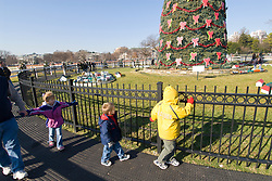 Washington DC; USA: Children at National Christmas Tree outside the White House, with gingerbread Victorian village.Photo copyright Lee Foster Photo # 17-washdc76172
