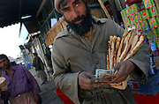 Man with money and bread in Kabul, Afghanistan. 2002