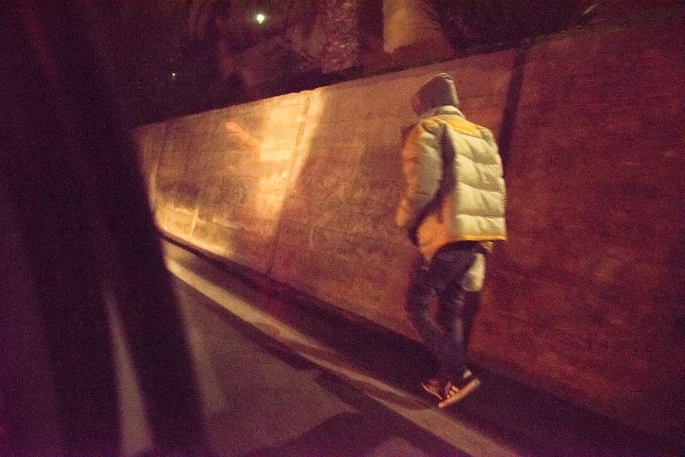 November 8, 2016 - Ventimiglia, Italy: A migrant  walks in the streets of Ventimiglia, Italy.<br /> <br /> 8 novembre 2016 - Vintimille, Italie: Un migrant marche dans les rues de Vintimille, en Italie.