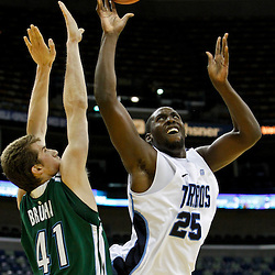 November 27, 2011; New Orleans, LA; San Diego Toreros forward/center Simi Fajemisin (25) shoots over Tulane Green Wave center Tomas Bruha (41) during the second half of the Hoops for Hope Classic at the New Orleans Arena. Tulane defeated San Diego 65-46. Mandatory Credit: Derick E. Hingle-US PRESSWIRE