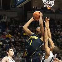 Michigan's Glenn Robinson III (1) drives to the basket during the second half of an NCAA college basketball game in University Park, Pa., Wednesday, Feb. 27, 2013.