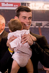 Gareth Bale with his daughter Alba Violet Jones during his official unveiling at Estadio Santiago Bernabeu on September 2, 2013 in Madrid, Spain.<br /> Previous Tottenham Hotspur player Bale has agreed a six-year deal believed to be worth  £83.5million which puts him in to the highest earning football player to date. Photo by : Oscar Gonzalez / i-Images<br /> SPAIN OUT