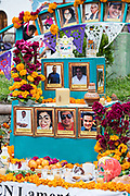 A Dead of the Dead altar known as an ofrenda dedicated to journalists killed during the Drug Wars in Mexico created by the PEN writers group during the Dia de Muertos festival in San Miguel de Allende, Mexico. The multi-day festival is to remember friends and family members who have died using calaveras, aztec marigolds, alfeniques, papel picado and the favorite foods and beverages of the departed.