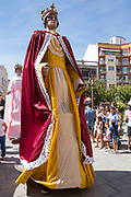 Children watch fiesta parade gigantes giant characters in Aranda de Duero, Castile and Leon, Spain