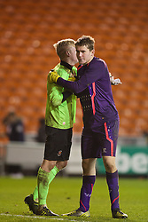 BLACKPOOL, ENGLAND - Wednesday, December 18, 2013: Liverpool's goalkeeper Ryan Crump embraces Blackpool's goalkeeper Connor Hunt after the penalty shoot-out during the FA Youth Cup 3rd Round match at Bloomfield Road. (Pic by David Rawcliffe/Propaganda)