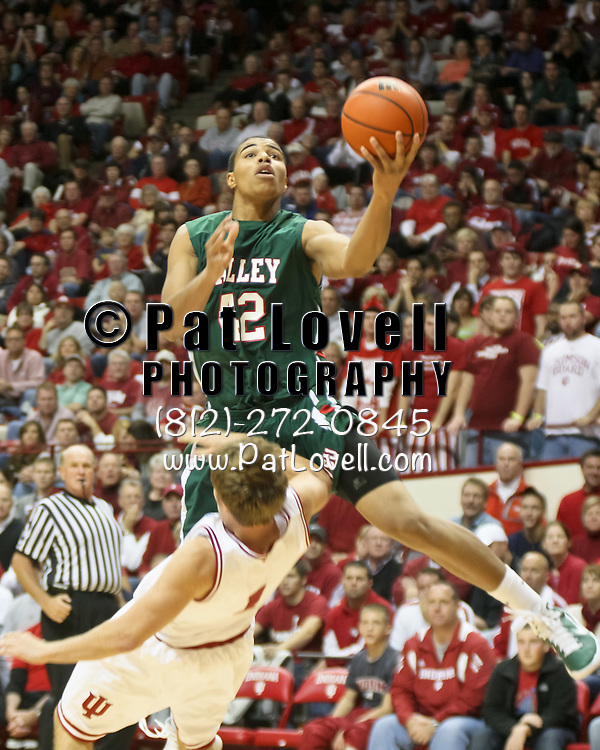 Mississippi Valley State Devils forward Jason Holmes (42) drives the lane and Indiana Hoosiers guard Jordan Hulls (1) takes the charge  in an NCAA matchup between Indiana and Mississippi Valley State at Assembly Hall in Bloomington.