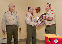 Gary Doucette with 26 years of service and Carl Gebhardt with 43 years of service receive dedication awards from Kurt Webber and Boy Scout Troop 243 Wednesday evening at the Gilford Community Center.  (l-r)  Carl Gebhardt, Gary Doucette, Bill Klubben and Brian Roper  (Karen Bobotas/for the Laconia Daily Sun)