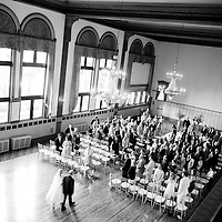 Alison is walked down the aisle by her father at her wedding to Matt at Chicago's Germania Place.