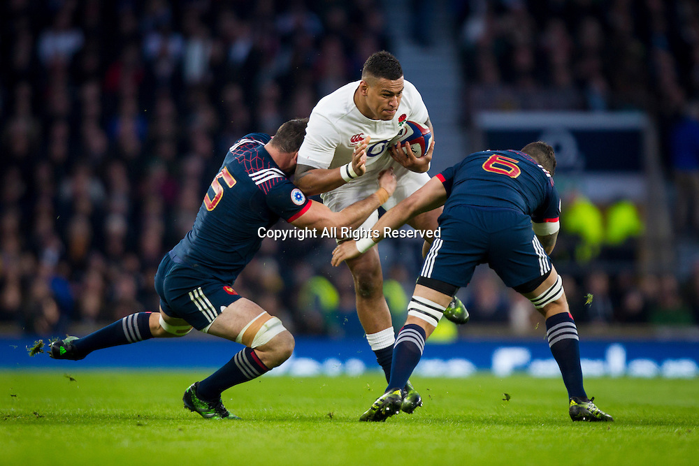 February 4th 2017, Twickenham, London, England;  6 Nations International rugby, England versus France; Nathan Hughes of England is tackled by Yoann Maestri and Damien Chouly of France