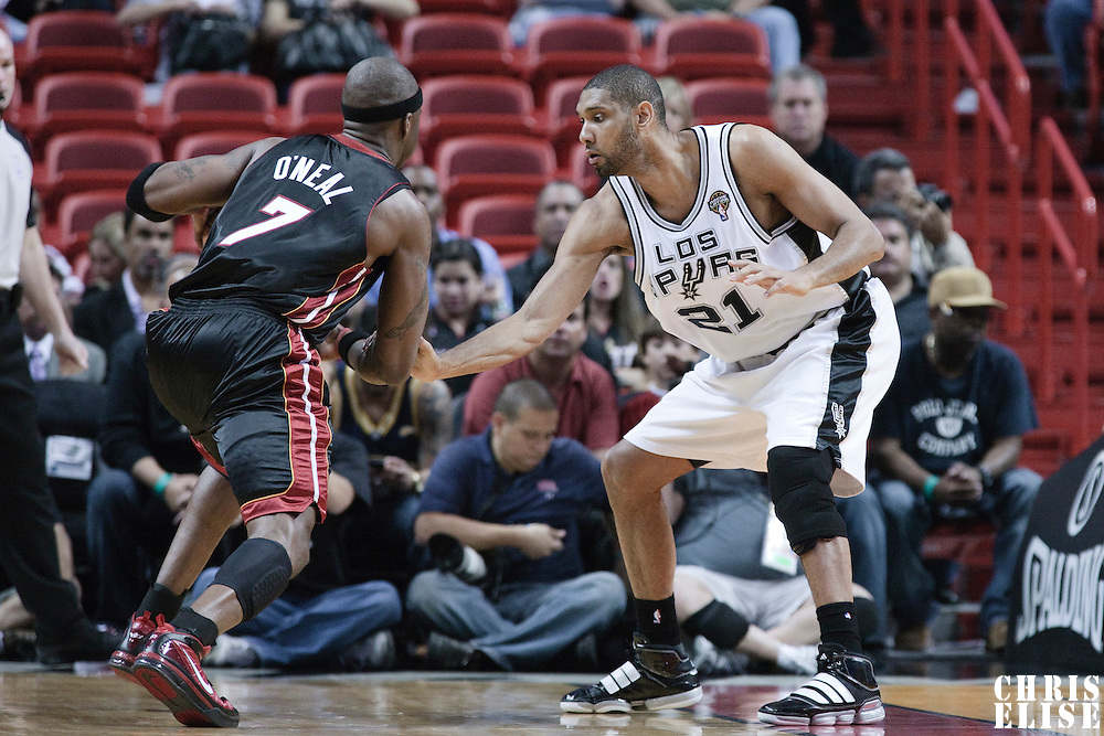 16 March 2010: San Antonio Spurs center Tim Duncan defends on Miami Heat center Jermaine O'Neal during the San Antonio Spurs 88-76 victory over the Miami Heat at the AmericanAirlines  Arena, in Miami, Florida, USA.
