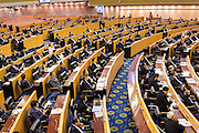 08 AUGUST 2014 - BANGKOK, THAILAND: Members of the Thai National Legislative Assembly (NLA) during their first meeting Friday in the Parlimanet Building in Bangkok to elect legislative leadership. The NLA was appointed by the Thai junta, formally called the National Council for Peace and Order (NCPO), and is supposed to guide Thailand back to civilian rule after a military coup overthrew the elected government in May. There are 197 members of the NLA. Membership is tilted towards military personnel. From the Royal Thai Army 40 members are Generals, 21 are Lt. Generals and 7 are Major Generals. From the Royal Thai Air Force 17 are Air Chief Marshals and 2 are Air Marshals. From the Royal Thai Navy, 14 are Admirals and 5 are Vice Admirals. There are also 6 Police Generals and 3 Police Lt. Generals. There are 187 men in the NLA and only 10 women.        PHOTO BY JACK KURTZ