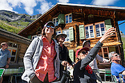 We loved hiking to the quiet retreat of Berghotel Obersteinberg, which offers tremendous views of waterfalls and peaks in Upper Lauterbrunnen Valley, in the canton of Bern, Switzerland, Europe. Lit by candle light at night, this romantic escape built in the 1880s recalls an earlier era without power. The main luxuries here are flush toilets down the hall, and traditional Swiss hot meals. The private double rooms lack electricity, and bowls of water serve as bath and sink. Obersteinberg is a 2-hour walk from Stechelberg, or 4 hours from Mürren, in one of the world's most spectacular glaciated valleys. From Obersteinberg, don't miss the 2-3 hours round trip to the deep-blue tarn of Oberhornsee in the upper glacial basin, beneath snowcapped Grosshorn, Breithorn and Tschingelhorn. The Swiss Alps Jungfrau-Aletsch region is honored as a UNESCO World Heritage Site. For licensing options, please inquire.