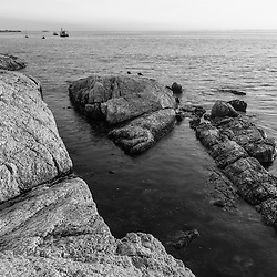 Rocks on the shoreline of Appledore Island, Maine in the Isles of Shoals.